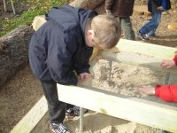 19. Digging & Building Area-Student enjoying sensory activity